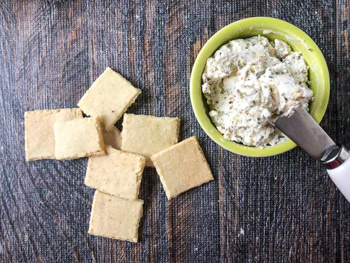 almond flour crackers with a bowl of cream cheese spread