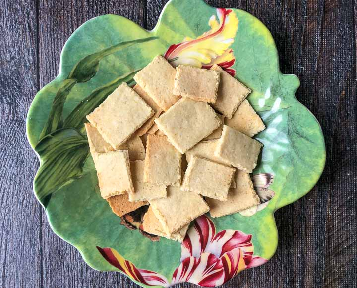 pretty green floral plate with scattered keto homemade crackers