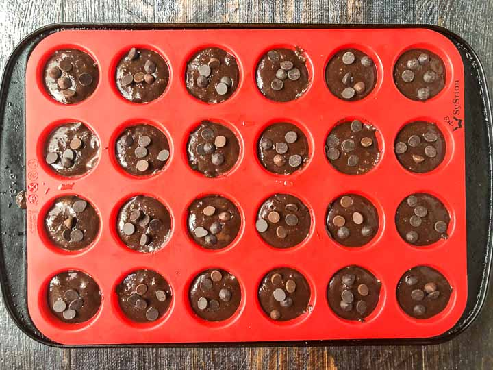 red silicone mini muffin tin filled and ready to be baked