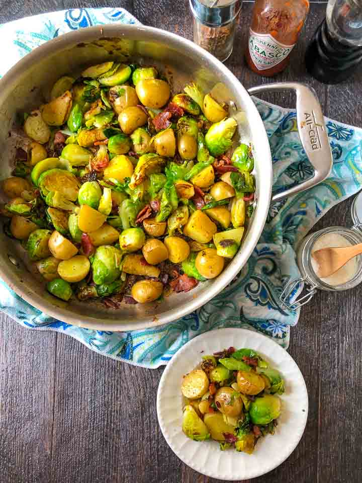 pan and plate with bacon, Brussels sprouts & potatoes side dish with paisley blue towel underneath