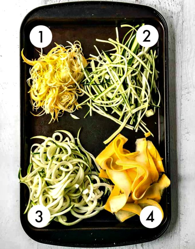 Raw veggie noodles using different sizes on a baking tray.