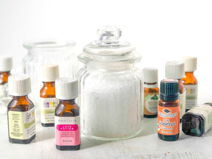 essential oil bottles and a jar of bath salts
