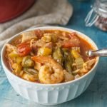 This low carb Jambalaya soup is a delicious combination of shrimp, chicken, sausage and vegetables in a spicy tomato based broth.  Eat as is for a low carb, Paleo soup or over rice for a tasty meal.