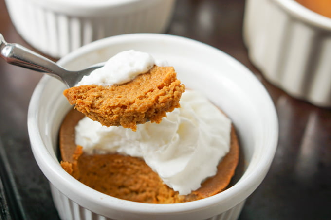 a spoon with a bite of low carb pumpkin pie taken out