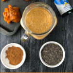 glass with low carb pumpkin protein smoothie and text