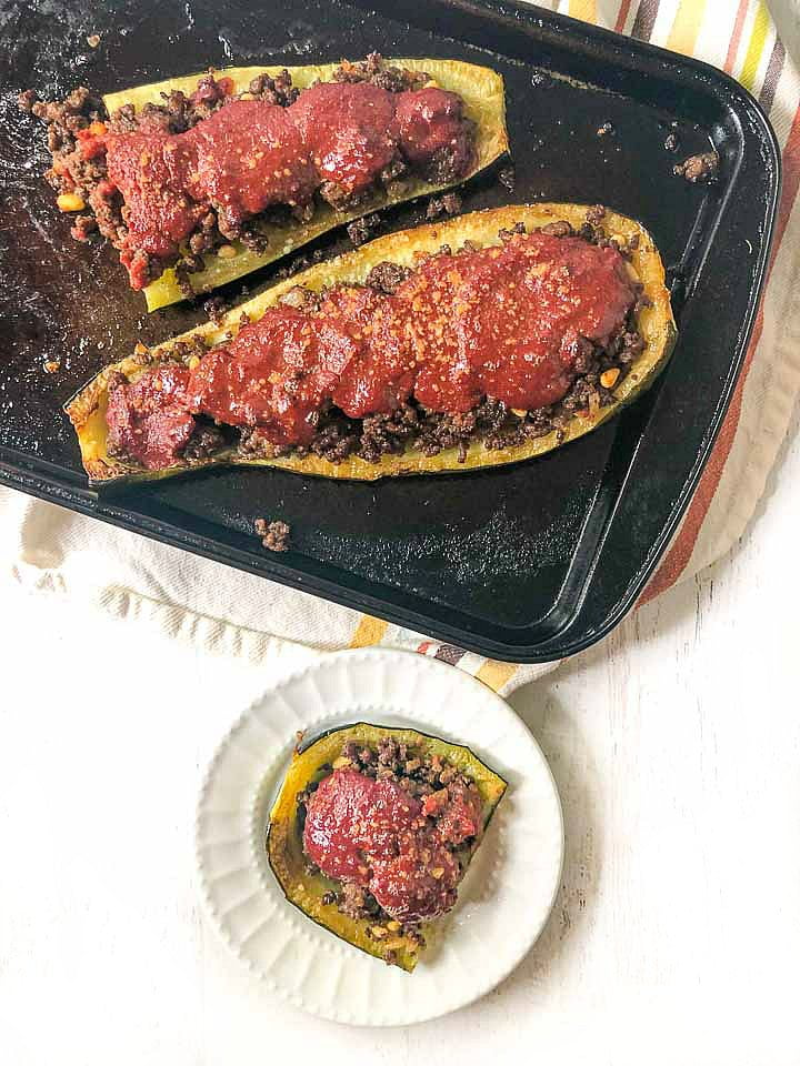 cookie sheet and white plate with low carb Middle Eastern Stuffed zucchini