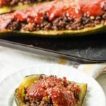 cookie sheet and white plate with low carb Middle Eastern Stuffed zucchini with text overlay
