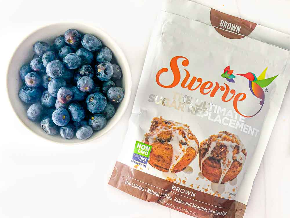bowl of fresh blueberries and Swerve brown sugar bag