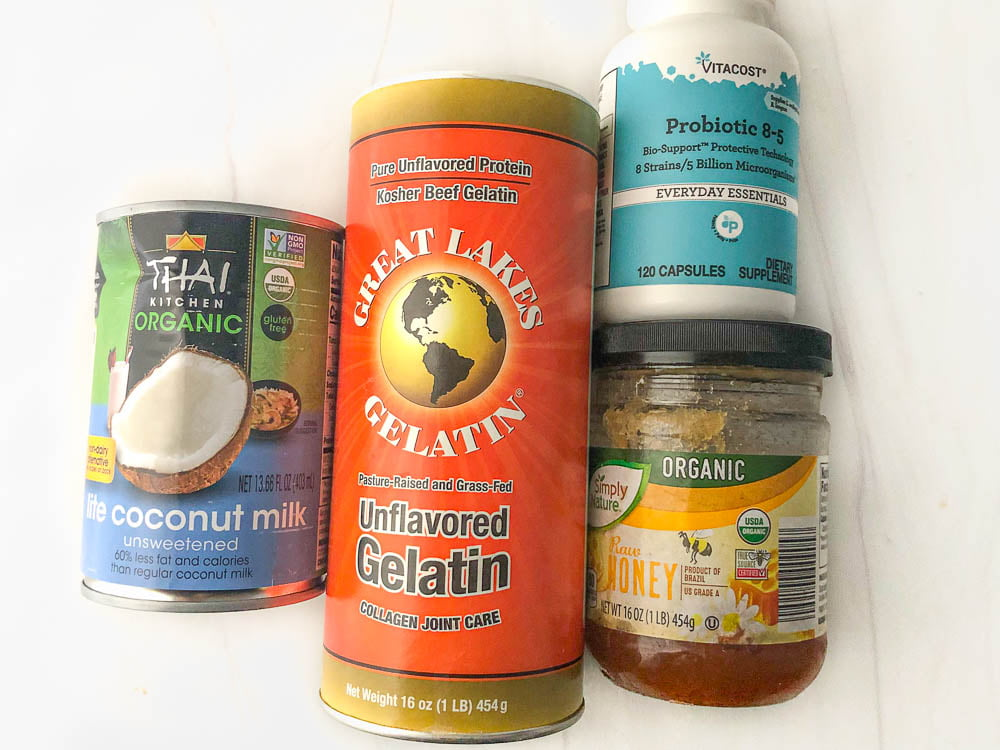 ingredients to make coconut yogurt - can of coconut milk, gelatin powder, probiotics capsules and hone