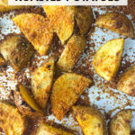 baking sheet with spicy roasted potatoes and text