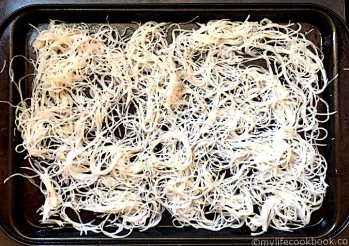 rosemary & garlic turnip noodles on a cookie sheet