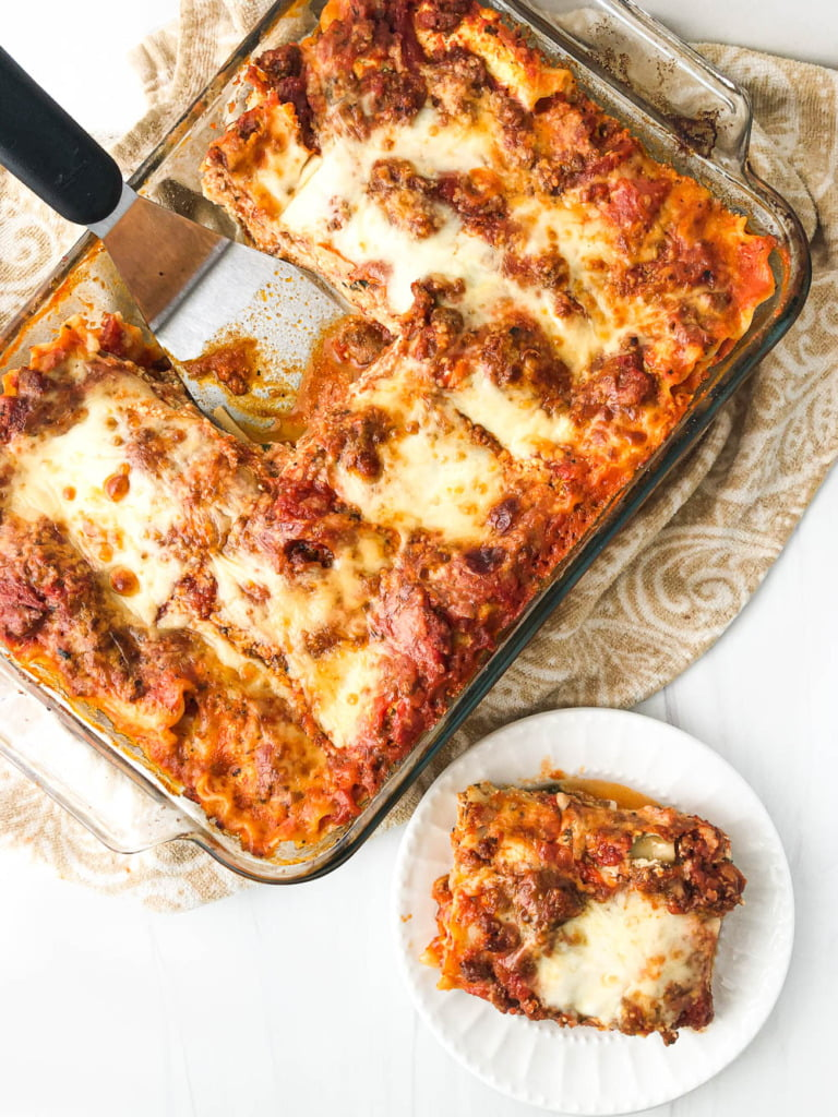 aerial view of a pan of delicious meat lasagna and a plate with a piece