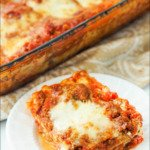 pan and white plate with classic homemade meat lasagna and text
