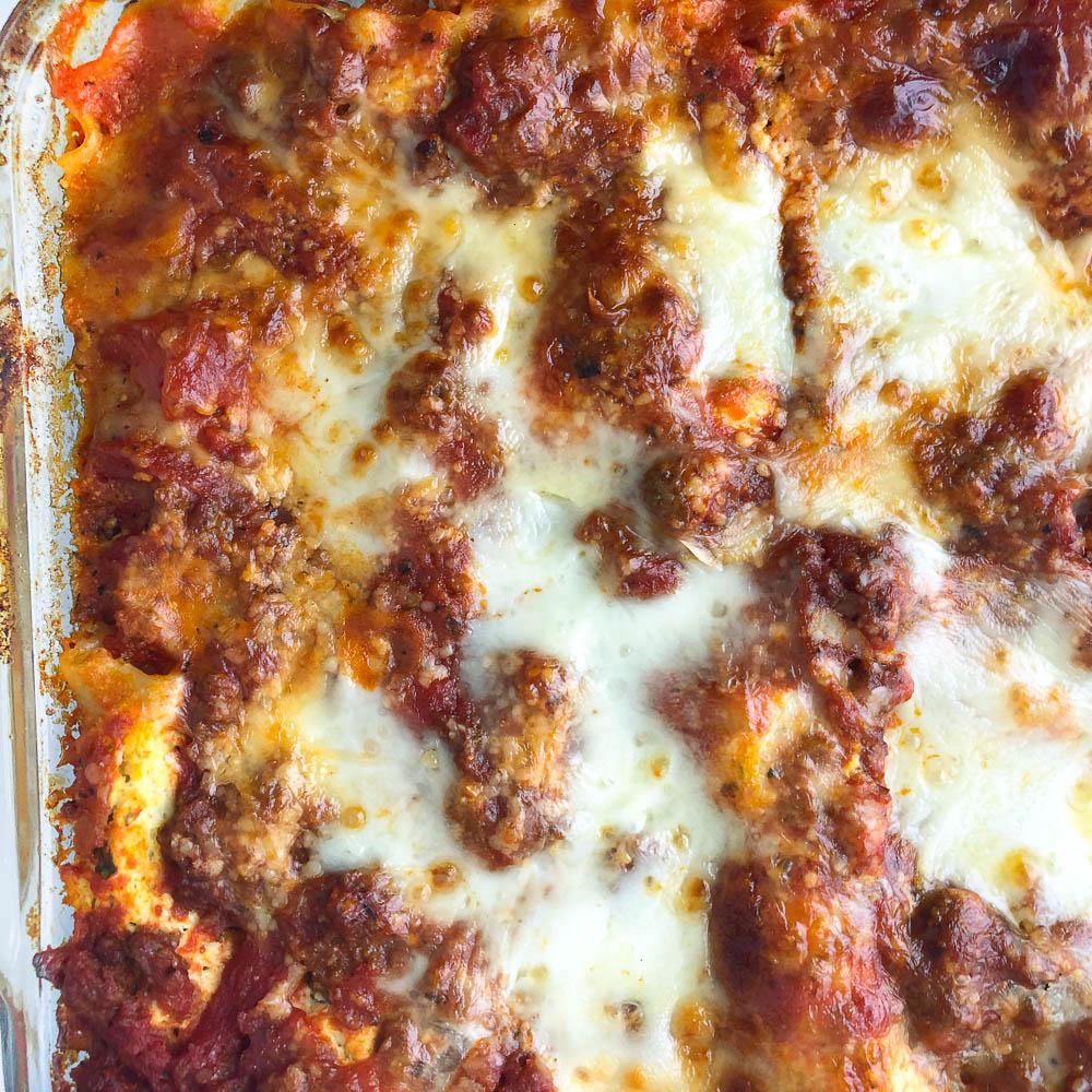 closeup of a pan of homemade lasagna with meat sauce