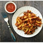 These delicious savory pizza waffles are not only grain free, they are also low carb. All you need are eggs, cheese, cauliflower, pepperoni and spices.
