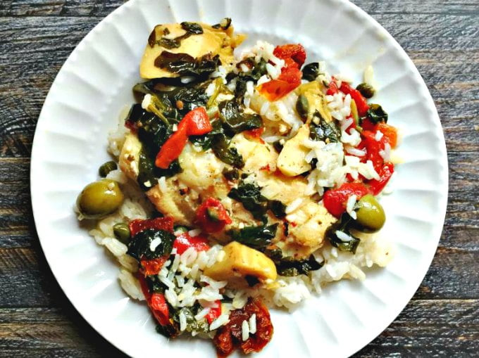 This easy Mediterranean fish dinner takes less than 20 minutes to make with ingredients you probably have on hand. So if you are looking for easy fish dinner recipes, try this easy, healthy and tasty fish dinner tonight! Tastes great over rice!