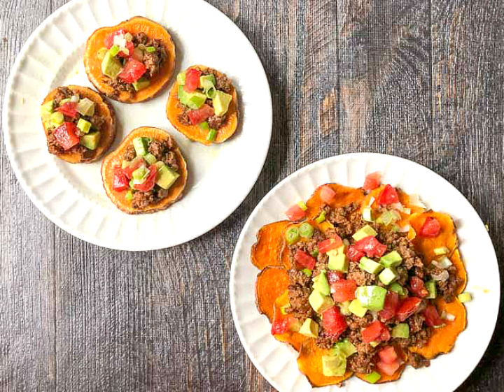 two white plates with sweet potato paleo nachos done two ways