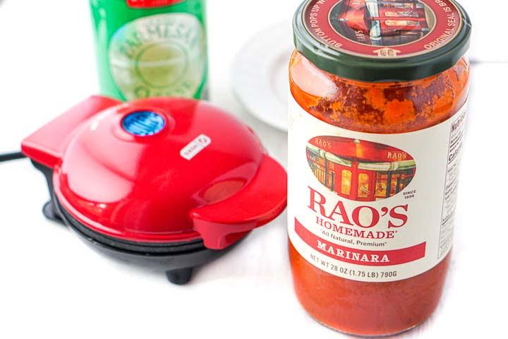 Rao's marinara sauce jar and a red mini waffle maker