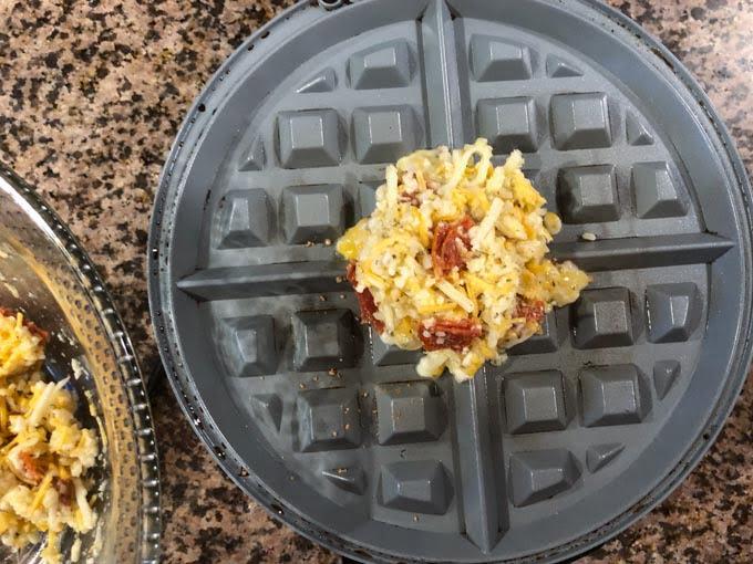 raw keto pizza dough on waffle iron