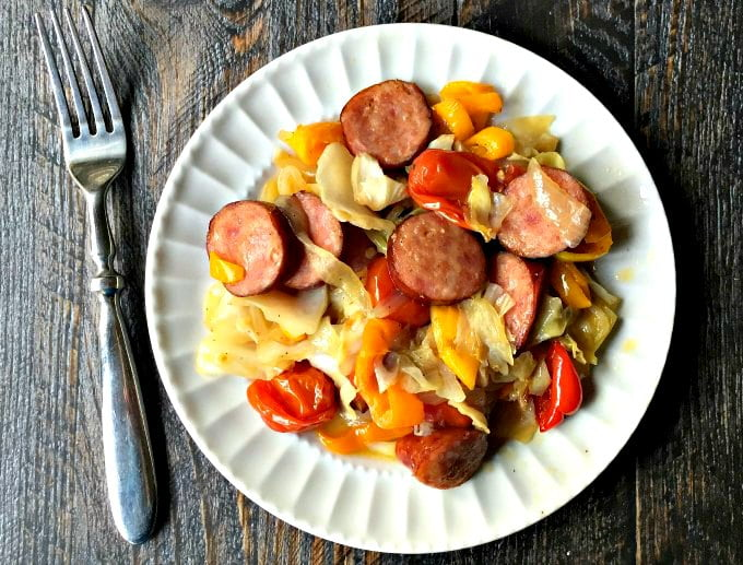 This cabbage & peppers kielbasa casserole is a very quick and easy dish that tastes delicious. Roasting the vegetables gives it an added sweetness that contrasts the bit of the kielbasa. Chop, mix, roast and you are done!
