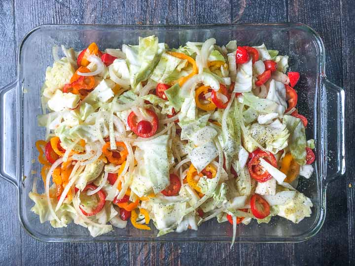raw chopped vegetables in clear baking dish