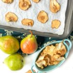 cookie sheet and blue dish with pear chips and a few fresh pears with text overlay