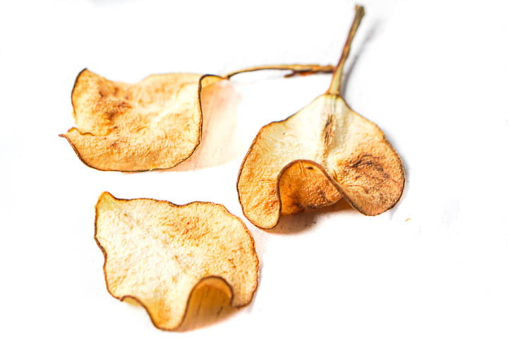 closeup of 3 baked pear chips