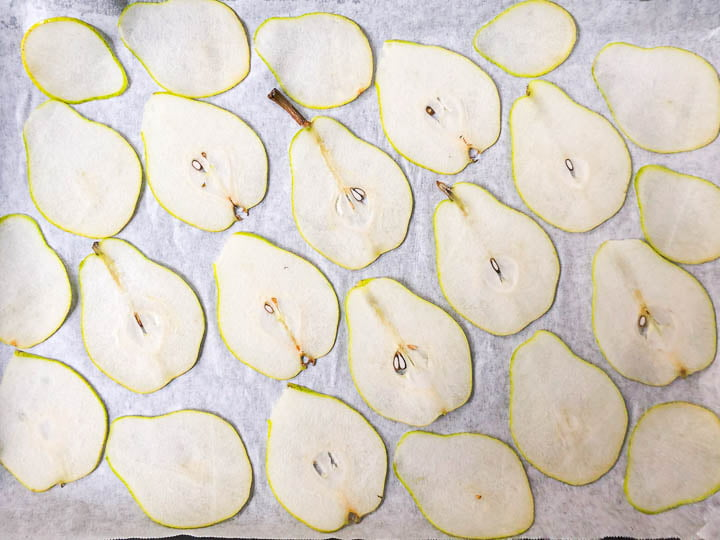 cookie sheet with fresh pear slices
