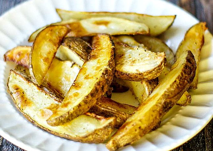 white plate with crispy steak fries