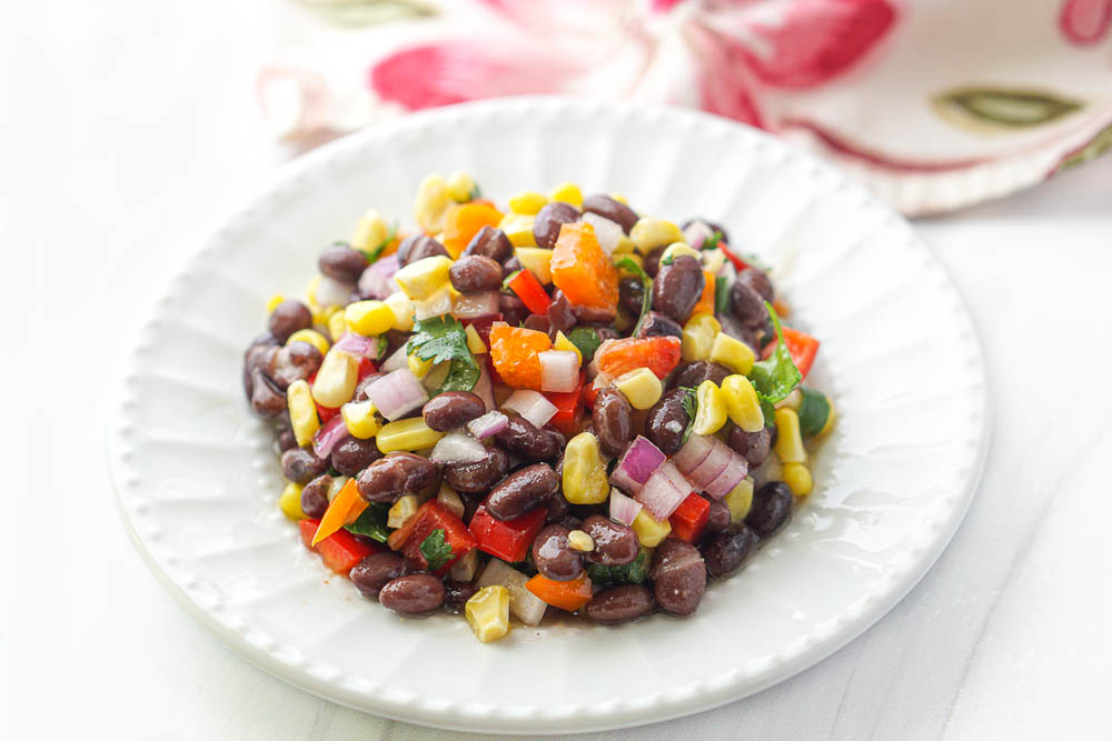 white plate of veggie picnic salad