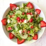 white bowl with strawberry caprese salad