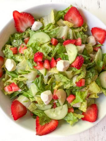 white bowl with strawberry caprese salad
