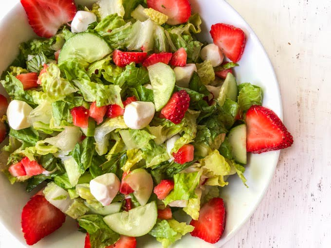 closeup of a bowl of strawberry caprese salad