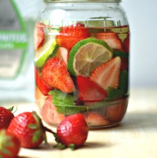 These fruit & herb infused liquors are a fun way to use all that ripe and luscious summer fruit. I have three delicious flavors for you: strawberry basil gin, apricot ginger vodka and strawberry lime tequila!