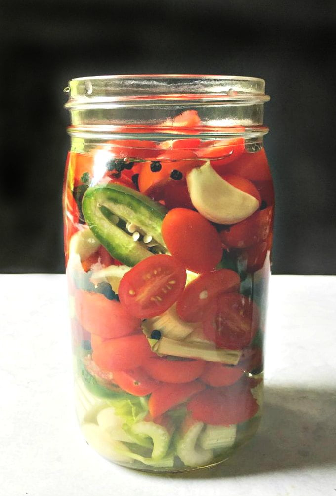 Bloody Mary Infused vodka is simply, vodka infused with peppers, tomatoes, celery, garlic and more for a low carb alternative to a Bloody Mary.