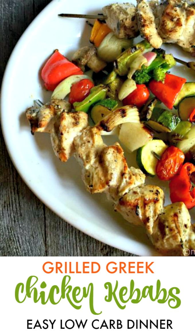white platter with chicken kebabs with vegetables
