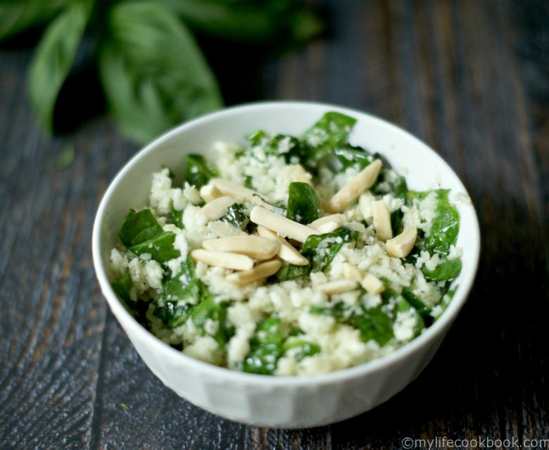 This Spinach & Herb Cauliflower Rice Pilaf takes only about 15 minutes to make and is full of healthy flavor while low in calories and carbs. A tasty Paleo dish!