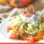closeup of taco stuffed peppers with text overlay