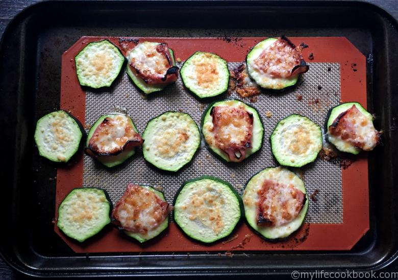 These Zucchini Ham & Cheese Bites are the perfect low carb, Paleo snack. Also a good way to use that garden zucchini in the summer time!