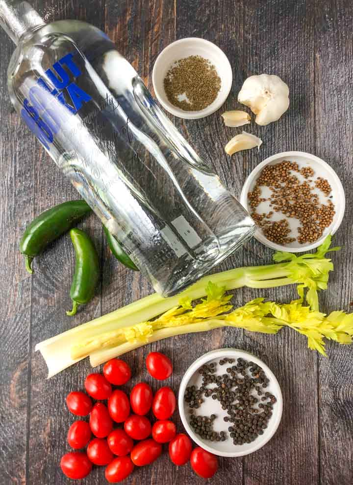 ingredients for a Bloody Mary infused Voka drink: Absolut vodka, jalapenos, celery seed black pepper corns, garlic tomato and celery
