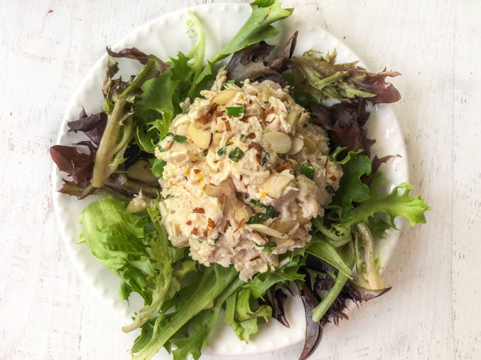 closeup of white plate with lettuce and low carb chicken salad