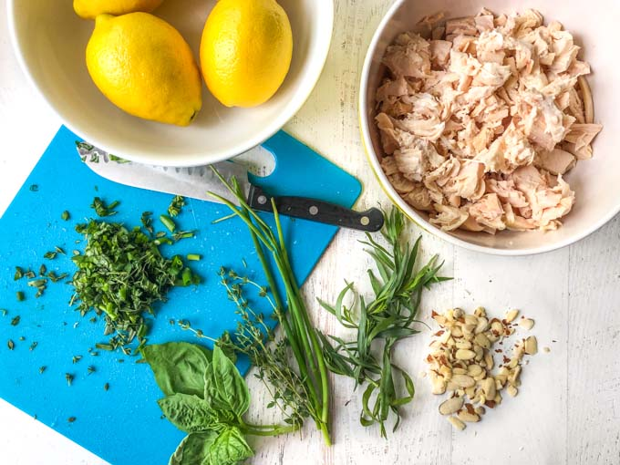 ingredients for chicken salad and herbs on a chopping board