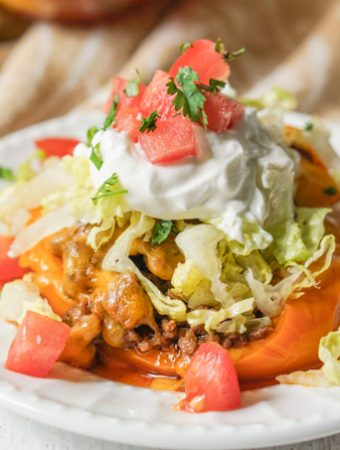 one low carb taco stuffed pepper on a white plate