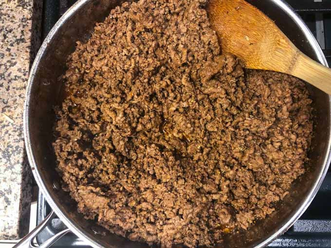 skillet with low carb taco meat and a spoon