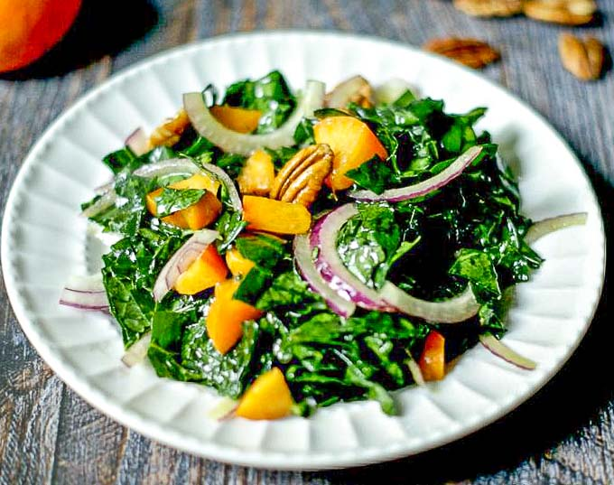 This apricot pecan kale salad is a great way to use that kale from your garden with the sweet tangy apricots and crunchy pecans all tossed with a sweet & sour dressing.