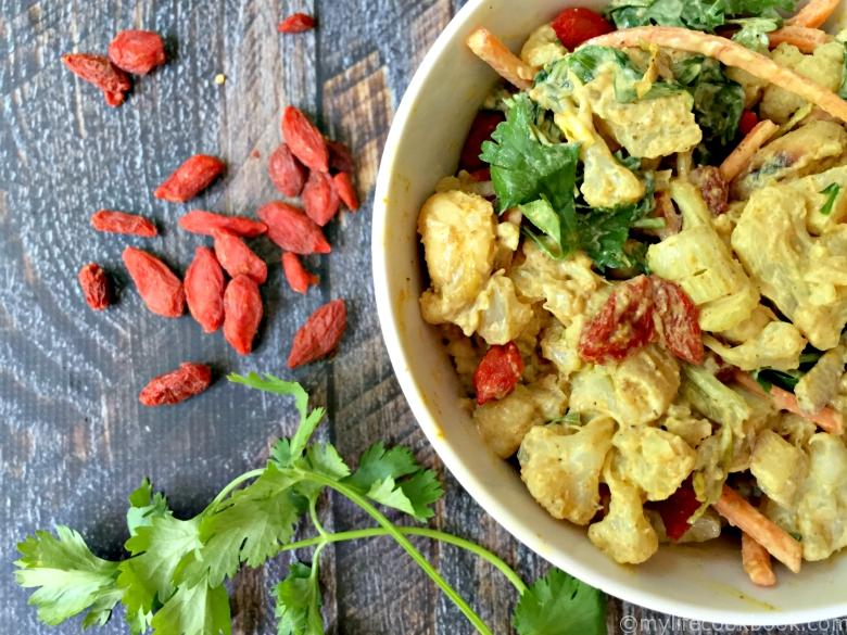 This curried cauliflower salad is packed with healthy ingredients and full of flavor for the perfect Paleo side dish.