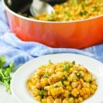 pan of spicy Mexican corn with text overlay
