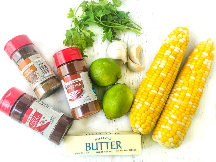 recipe ingredients: chili powder, cumin, paprika, garlic, limes, cilantro, butter and leftover ears of corn