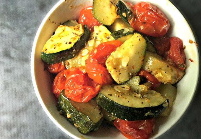 This roasted Italian zucchini dish is a great dish for using that summer zucchini. It's so delicious you can eat as is or over rice, pasta or fish!