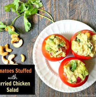 These tomatoes stuffed with curried chicken salad are a delicious way to use those fresh tomatoes from the garden. The flavorful chicken salad is nested in the cool tomatoes and makes a delicious lunch!